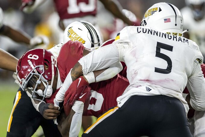 Alabama running back Trey Sanders (6) runs into Southern Mississippi defensive lineman Everitt Cunningham (5) during the second half of an NCAA college football game, Saturday, Sept. 25, 2021, in Tuscaloosa, Ala. (AP Photo/Vasha Hunt)