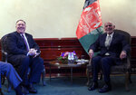 US Secretary of State Mike Pompeo, left, meets with Afghan President Ashraf Ghani during the 56th Munich Security Conference (MSC) in Munich, southern Germany, on Friday, Feb. 14, 2020. The 2020 edition of the Munich Security Conference (MSC) takes place from Feb. 14 to 16. (Andrew Caballero-Reynolds/Pool photo via AP)