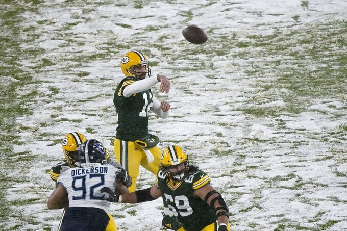 Green Bay Packers' Aaron Rodgers throws during the first half of an NFL football game against the Tennessee Titans Sunday, Dec. 27, 2020, in Green Bay, Wis. (AP Photo/Morry Gash)