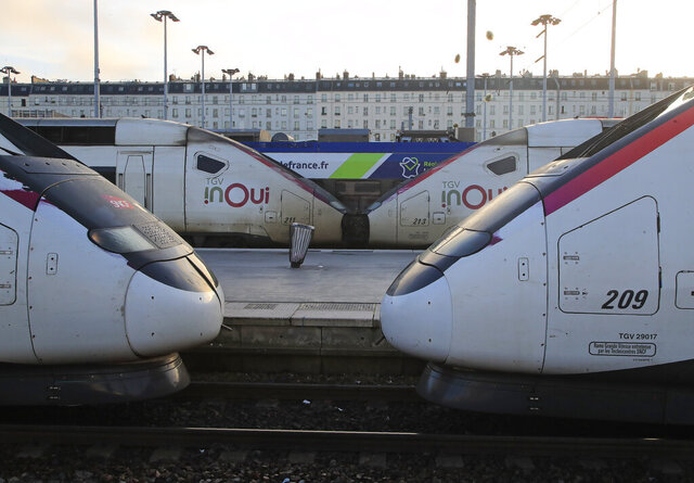 High-speed trains are pictured at Gare du Nord train station in Paris, Wednesday, Dec. 18, 2019. With French President Emmanuel Macron under heavy pressure over his pension reform plans, government officials are meeting with employers and unions on Wednesday to consider the way forward. (AP Photo/Michel Euler)