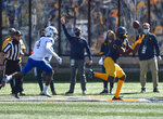 West Virginia wide receiver Bryce Ford-Wheaton (0) makes a catch for a touchdown against Kansas   during an NCAA college football game, Saturday, Oct. 17, 2020, in Morgantown, W.Va. (William Wotring/The Dominion-Post via AP)