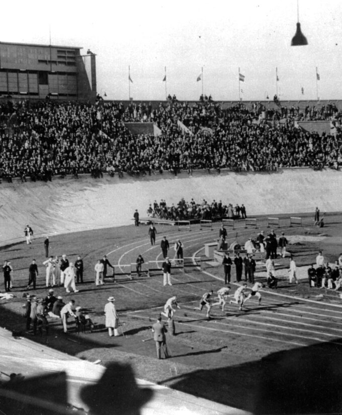 FILE - In this March 1928, file photo, the world's greatest sprinters are off from their marks at the start of one of the heats in the 100-meter race at the Opening of the Olympic games in Amsterdam, The Netherlands. Percy Williams, an unknown schoolboy from Canada, captured the finals. (AP Photo/File)