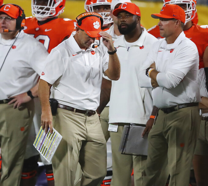 Clemson coach Dabo Swinney reacts after a sack while walking the sideline during the second half of the team's NCAA college football game against Georgia on Saturday, Sept. 4, 2021, in Charlotte, N.C. (Curtis Compton/Atlanta Journal-Constitution via AP)