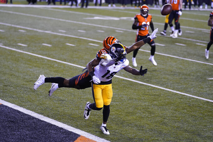 Cincinnati Bengals' William Jackson (22) is called for pass interference against Pittsburgh Steelers' Diontae Johnson (18) during the second half of an NFL football game, Monday, Dec. 21, 2020, in Cincinnati. (AP Photo/Michael Conroy)