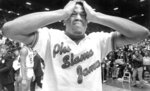 FILE - In this April 4, 1983, file photo, Houston's Renaldo Thomas holds his head after losing 54-52 to North Carolina State in the championship game of the NCAA college basketball championship game in Albuquerque, N.M. (Larry Reese/Houston Chronicle via AP, File)
