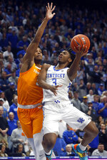 Kentucky's Tyrese Maxey (3) shoots while defended by Tennessee's Josiah-Jordan James, left, during the first half of an NCAA college basketball game, Tuesday, March 3, 2020, in Lexington, Ky. (AP Photo/James Crisp)