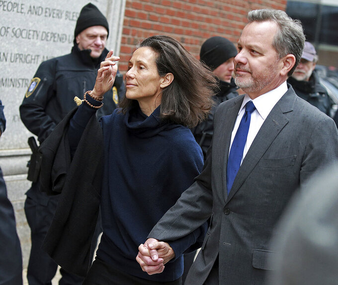 FILE - In this Friday, March 29, 2019, file photo, William McGlashan, right, of Mill Valley, Calif., arrives at the federal courthouse in Boston for a hearing in a nationwide college admissions bribery scandal. McGlashan, a former private equity executive who cofounded an investment fund with U2′s Bono was sentenced Wednesday, May 12, 2021,  to three months in prison for his role in the college admissions bribery scheme. The former TPG Capital senior executive, admitted in February to paying $50,000 to have someone secretly correct his son's ACT answers. (Matt Stone/The Boston Herald via AP, File)