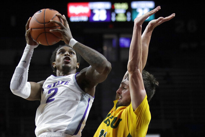 Kansas State guard Cartier Diarra (2) shoots while covered by North Dakota State guard Jared Samuelson, right, during the second half of an NCAA college basketball game in Manhattan, Kan., Tuesday, Nov. 5, 2019. (AP Photo/Orlin Wagner)