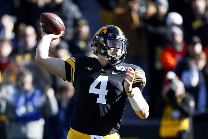 Iowa quarterback Nate Stanley throws a pass during the first half of an NCAA college football game against Illinois, Saturday, Nov. 23, 2019, in Iowa City, Iowa. Iowa won 19-10. (AP Photo/Charlie Neibergall)