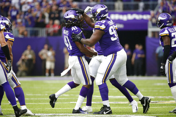 Minnesota Vikings defensive back Anthony Harris (41) celebrates with teammate Shamar Stephen (93) after intercepting a pass during the first half of an NFL football game against the Atlanta Falcons, Sunday, Sept. 8, 2019, in Minneapolis. (AP Photo/Bruce Kluckhohn)