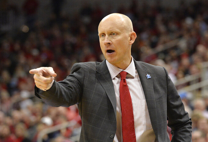 Louisville head coach Chris Mack directs his team during the second half of an NCAA college basketball game against Clemson in Louisville, Ky., Saturday, Feb. 16, 2019. Louisville won 56-55. (AP Photo/Timothy D. Easley)