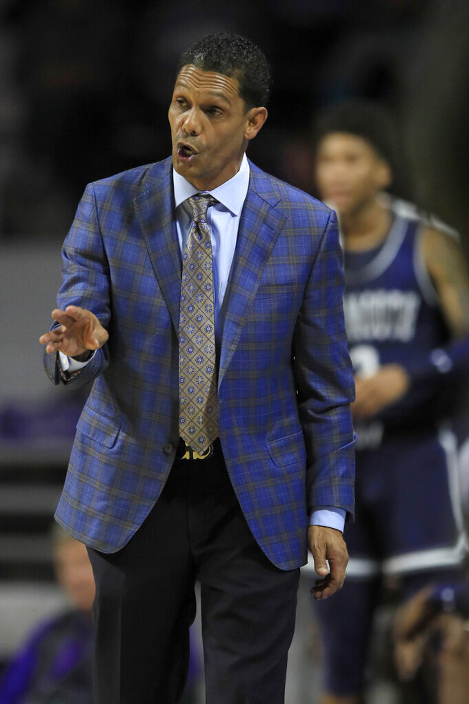 Monmouth coach King Rice talks to some of his players during the first half of an NCAA college basketball game against Kansas State in Manhattan, Kan., Wednesday, Nov. 13, 2019. (AP Photo/Orlin Wagner)