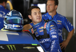 FILE - In this Feb. 15, 2019, file photo, Kyle Larson gets into his car during Daytona 500 auto race practice at Daytona International Speedway in Daytona Beach, Fla. Larson says he personally apologized to team owner Rick Hendrick this week after jokingly suggesting during an interview that Hendrick Motorsports cheats. While the Chip Ganassi Racing star doesn't plan to stop the opinionated honesty that earned him that catchy new nickname of Blunt and spawned a few accompanying memes, Larson also realizes his delivery can improve. (AP Photo/Chris O'Meara, File)