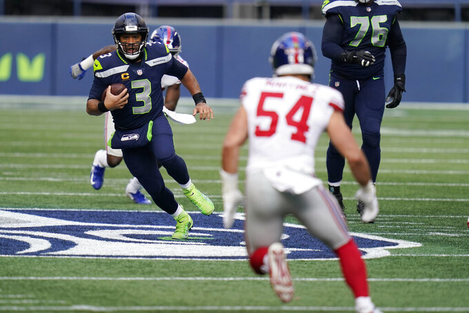 Seattle Seahawks quarterback Russell Wilson (3) scrambles against the New York Giants during the first half of an NFL football game, Sunday, Dec. 6, 2020, in Seattle. (AP Photo/Elaine Thompson)