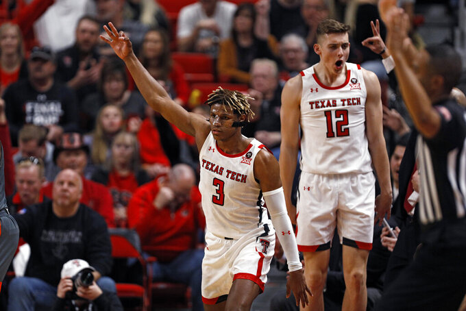 Texas Tech's Jahmi'us Ramsey (3) celebrates after scoring a three-point shot during the second half of an NCAA college basketball game against Texas-Rio Grande Valley, Saturday, Dec. 21, 2019, in Lubbock, Texas. (AP Photo/Brad Tollefson)