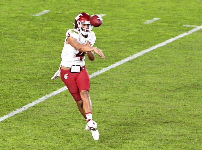 Washington State quarterback Jayden de Laura passes against Southern California in the first half of an NCAA college football game in Los Angeles, Sunday, Dec. 6, 2020. (Keith Birmingham/The Orange County Register via AP)
