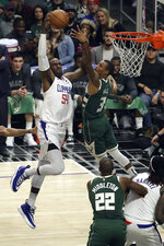 Los Angeles Clippers' Patrick Patterson (54) dunks past Milwaukee Bucks' George Hill (3) during the first half of an NBA basketball game Wednesday, Nov. 6, 2019, in Los Angeles. (AP Photo/Marcio Jose Sanchez)
