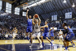 Butler's Joey Brunk (50) catches a pass while being defended by Creighton's Mitch Ballock (24) and Martin Krampelj (15) during the first half of an NCAA college basketball game, Saturday, Jan. 5, 2019, in Indianapolis. (AP Photo/Darron Cummings)