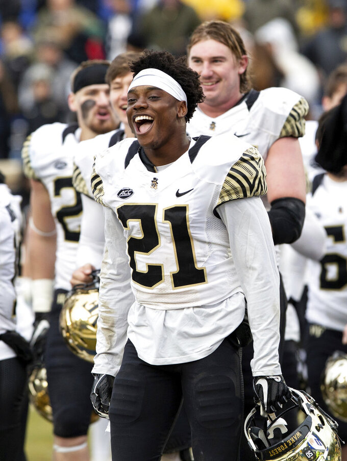 Wake Forest's Essang Bassey (21) celebrates after a victory over Duke in an NCAA college football game in Durham, N.C., Saturday, Nov. 24, 2018. (AP Photo/Ben McKeown)