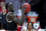 Nebraska forward Lat Mayen goes up for a shot against Maryland during the second half of an NCAA college basketball game, Tuesday, Feb. 16, 2021, in College Park, Md. Maryland won 64-50. (AP Photo/Julio Cortez)