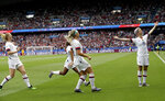 FILE - This June 28, 2019 file photo shows United States' Megan Rapinoe, right, celebrating after scoring her team's first goal during the Women's World Cup quarterfinal soccer match between France and the United States in Paris. (AP Photo/Alessandra Tarantino, File)