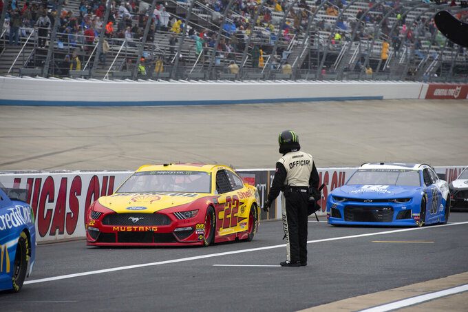 Drivers entering pit road after a NASCAR Cup Series auto race was postponed due to inclement weather conditions Sunday, May 5, 2019, at Dover International Speedway in Dover, Del. (AP Photo/Jason Minto)