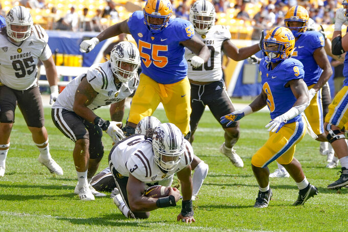 Western Michigan linebacker Zaire Barnes (3) recovers a fumble by Pittsburgh during the first half an NCAA college football game, Saturday, Sept. 18, 2021, in Pittsburgh. (AP Photo/Keith Srakocic)