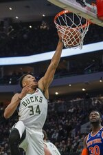 Milwaukee Bucks' Giannis Antetokounmpo dunks during the second half of an NBA basketball game against the New York Knicks Tuesday, Jan. 14, 2020, in Milwaukee. (AP Photo/Morry Gash)