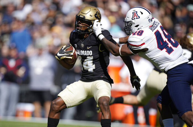 Arizona linebacker Jerry Roberts, right, stops Colorado wide receiver Dimitri Stanley after a short gain in the first half of an NCAA college football game Saturday, Oct. 16, 2021, in Boulder, Colo. (AP Photo/David Zalubowski)
