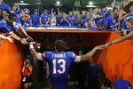 Florida quarterback Feleipe Franks greets fans as he leaves the field after Florida defeated LSU i27-19 in an NCAA college football game, Saturday, Oct. 6, 2018, in Gainesville, Fla. (AP Photo/John Raoux)
