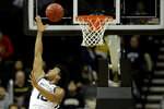 Butler forward Bryce Nze (10) puts up a shot during the first half of an NCAA college basketball game against Stanford Tuesday, Nov. 26, 2019, in Kansas City, Mo. (AP Photo/Charlie Riedel)