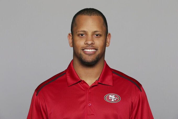FILE - This 2016, file photo shows Keanon Lowe of the San Francisco 49ers NFL football team. Lowe, a former analyst for the 49ers and wide receiver at the University of Oregon, subdued a person with a gun who appeared on a Portland, Oregon high school campus Friday, May 17, 2019. Lowe is now a coach at Parkrose High School. (AP Photo/File)