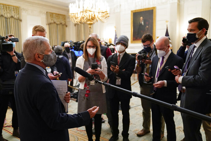 Dr. Anthony Fauci, director of the National Institute of Allergy and Infectious Diseases, talks with reporters before an event with President Joe Biden on the coronavirus in the State Dinning Room of the White House, Thursday, Jan. 21, 2021, in Washington. (AP Photo/Alex Brandon)