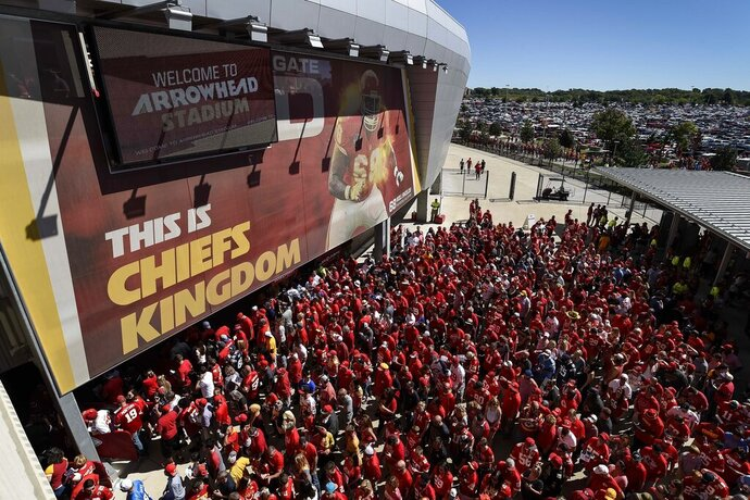 FILE - In this Sept. 11, 2016, file photo, Kansas City Chiefs fans line up to enter Arrowhead Stadium before their NFL football game against the San Diego Chargers in Kansas City, Mo. The crippling coronavirus pandemic has brought the entire world — including the sports world — to a standstill, and it shows no sign of going away anytime soon. That has left fans, stadium workers, team owners, sponsors and yes, even players, wondering what life will be like when games finally resume. (AP Photo/Reed Hoffmann, File)