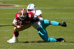 Miami Dolphins outside linebacker Elandon Roberts, right, sacks San Francisco 49ers quarterback Jimmy Garoppolo (10) during the first half of an NFL football game in Santa Clara, Calif., Sunday, Oct. 11, 2020. (AP Photo/Tony Avelar)