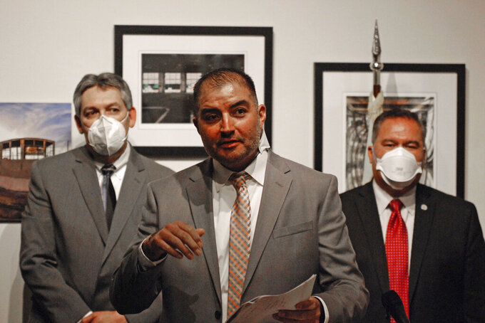 New Mexico Workforce Solutions Secretary Ricky Serna discusses plans for reform to the state's system for distributing unemployment benefits that include a major expansion in staffing, at a news conference on Friday, June 11, 2021, at the state Capitol building in Santa Fe, N.M. Gov. Michelle Lujan Grisham said she will use federal funds to replenish the state's depleted unemployment insurance trust and avoid future tax increases on businesses. The Workforce Solutions Department that oversees unemployment claims is embarking is hiring 110 new employees and embarking on reforms aimed at improving efficiency and service. (AP Photo/Morgan Lee)