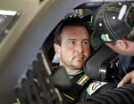 Kurt Busch, left, talks with a crew member before going out on the track during a NASCAR auto racing practice session at Daytona International Speedway, Saturday, Feb. 10, 2018, in Daytona Beach, Fla. (AP Photo/John Raoux)