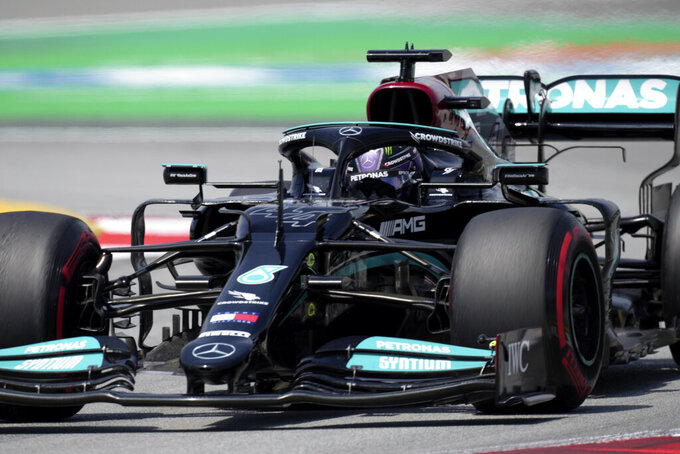 Mercedes driver Lewis Hamilton of Britain steers his car during the first free practice for the Spanish Formula One Grand Prix at the Barcelona Catalunya racetrack in Montmelo, just outside Barcelona, Spain, Friday, May 7, 2021. The Spanish Grand Prix will be held on Sunday. (AP Photo/Emilio Morenatti)