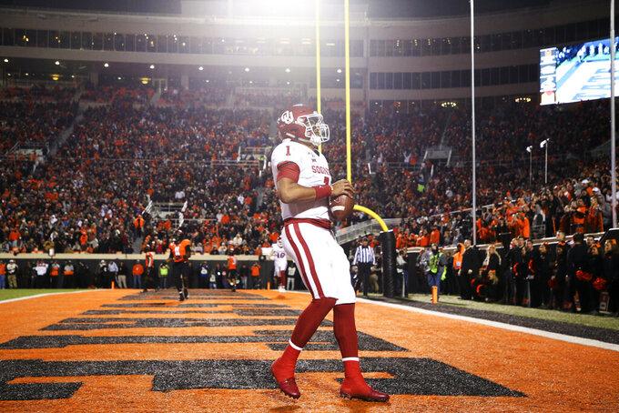 Oklahoma quarterback Jalen Hurts (1) catches a touchdown pass during an NCAA college football game against Oklahoma State, Saturday, Nov. 30, 2019, in Stillwater, Okla. (Ian Maule/Tulsa World via AP)
