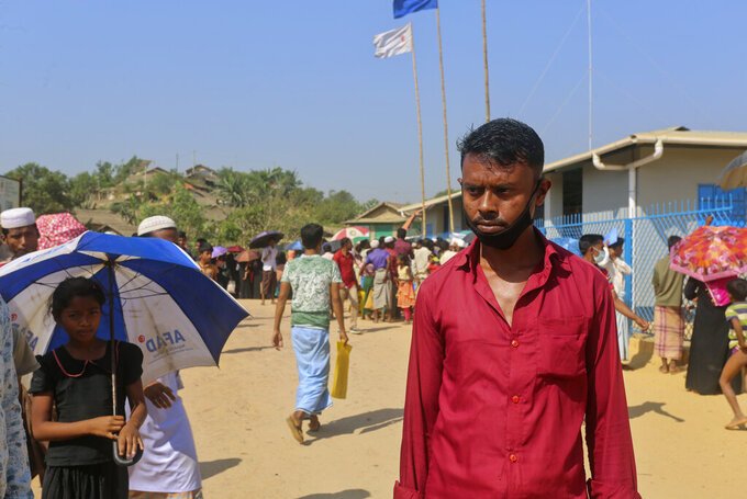 """In this Wednesday, April 1, 2020, photo, Rohingya refugee Sagir Ahmed, 33, stands at the Kutupalong refugee camp, Cox's Bazar, Bangladesh. """"People have been waiting in queues for aid for a whole week. They will definitely get sick in this situation. The relief work isn't being done here. So, people are going to die anyway from diseases,"""" he said. Aid workers are bracing for a possible outbreak of the coronavirus in one of the world's largest refugee camps in Bangladesh, but officials are already warning that containing the disease among more than 1 million tightly packed Rohingya Muslims will be a daunting task. (AP Photo/Suzauddin Rubel)"""