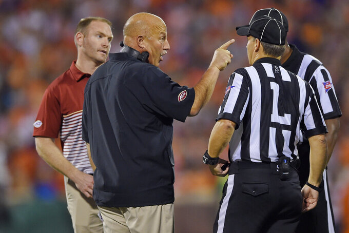 Boston College head coach Steve Addazio, front left, speaks to officials during the first half of an NCAA college football game against Clemson, Saturday, Oct. 26, 2019, in Clemson, S.C. (AP Photo/Richard Shiro)