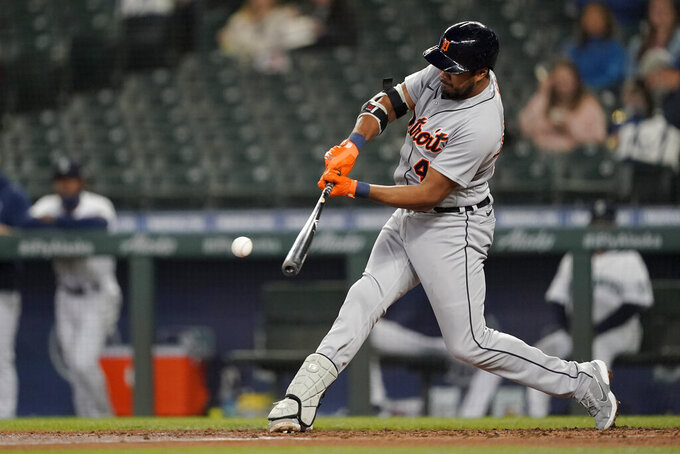 Detroit Tigers' Jeimer Candelario grounds out to first, allowing Robbie Grossman to score from third during the third inning of a baseball game against the Seattle Mariners, Tuesday, May 18, 2021, in Seattle. (AP Photo/Ted S. Warren)