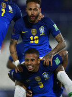 Brazil's Neymar, top, celebrates with teammate Gabriel Jesus after scoring his side's opening goal against Paraguay during a qualifying soccer match for the FIFA World Cup Qatar 2022 at Defensores del Chaco stadium in Asuncion, Paraguay, Tuesday, June 8, 2021. (AP Photo/Jorge Saenz)