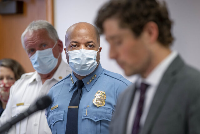 FILE - In this May 28, 2020, file photo, Minneapolis Police Chief Medaria Arradondo, center, listens as Minneapolis Mayor Jacob Frey becomes emotional during a news conference in Minneapolis, Minn. George Floyd's death and the protests it ignited nationwide over racial injustice and police brutality have raised questions about whether Arradondo — or any chief — can fix a department that's now facing a civil rights investigation. (Elizabeth Flores/Star Tribune via AP, File)