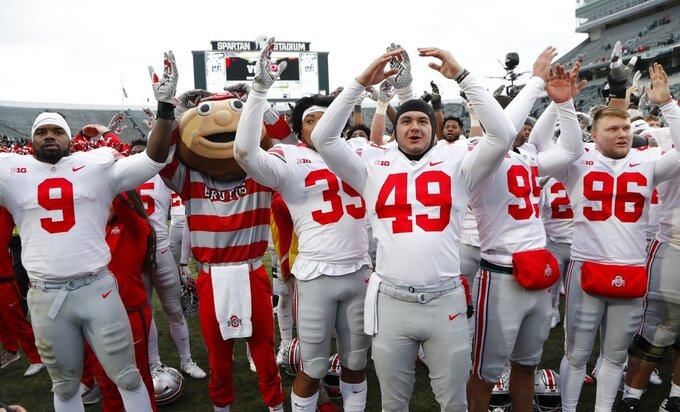 "Ohio State players sing ""Carmen Ohio"" after their NCAA college football game against the Michigan State, Saturday, Nov. 10, 2018, in East Lansing, Mich. (AP Photo/Carlos Osorio)"