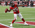 Atlanta Falcons running back Ito Smith throws the ball to the fans after scoring against the New York Jets during the first half of an NFL football preseason game Thursday, Aug. 15, 2019, in Atlanta. (Curtis Compton/Atlanta Journal Constitution via AP)