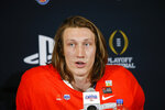 Clemson quarterback Trevor Lawrence speaks during a news conference after the team's 29-23 win over Ohio State in the Fiesta Bowl NCAA college football playoff semifinal Saturday, Dec. 28, 2019, in Glendale, Ariz. (AP Photo/Ross D. Franklin)