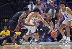 LSU guard Skylar Mays (4) goes after the loose ball between Nicholls forward Elvis Harvey Jr. (23), left, and Nicholls guard Brandon Moore Jr. (21) as teammate LSU forward Trendon Watford (2) watches in the first half of an NCAA college basketball game, Saturday, Nov. 16, 2019, in Baton Rouge, La. (AP Photo/Bill Feig)