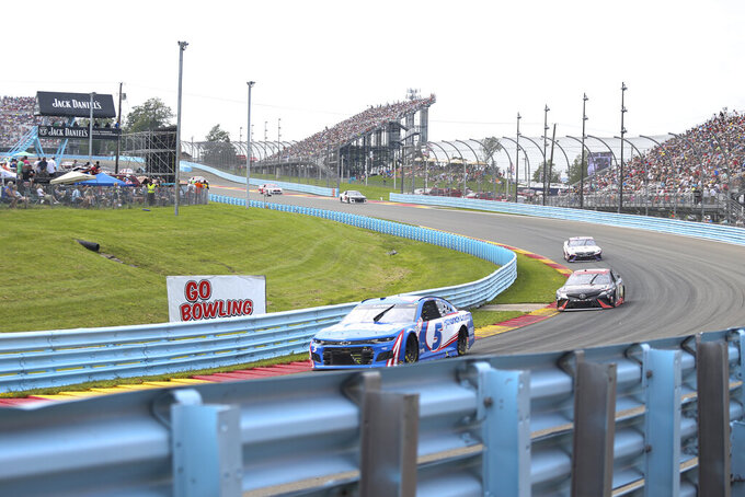 Kyle Larson (5) turns into the esses ahead of Martin Truex Jr. and Denny Hamlin during a NASCAR Cup Series auto race in Watkins Glen, N.Y., on Sunday, Aug. 8, 2021. (AP Photo/Joshua Bessex)