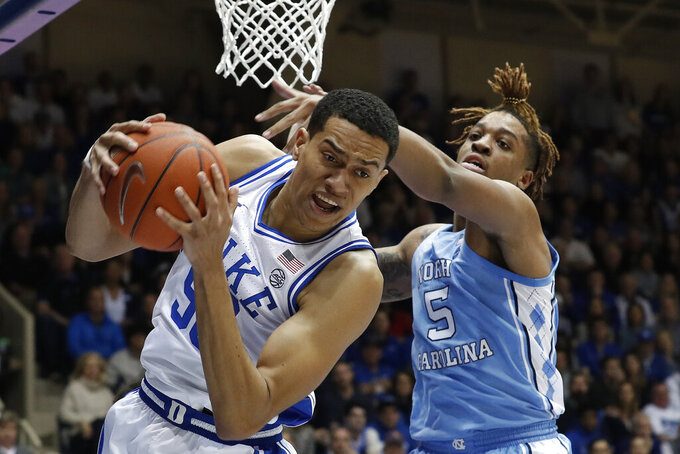 Duke forward Justin Robinson grabs a rebound while North Carolina forward Armando Bacot (5) defends during the first half of an NCAA college basketball game in Durham, N.C., Saturday, March 7, 2020. (AP Photo/Gerry Broome)